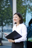 Young Asian female executive holding file Royalty Free Stock Photos