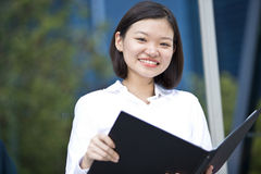 Young Asian female executive holding file Stock Images
