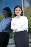 Young Asian female executive smiling Royalty Free Stock Photos