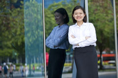 Young Asian female executive smiling Royalty Free Stock Photography