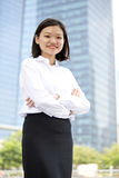Young Asian female executive smiling Stock Photography