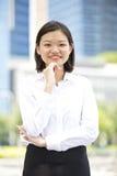 Young Asian female executive smiling Stock Photos