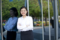 Young Asian female executive smiling Stock Photo