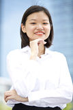 Young Asian female executive smiling Stock Images