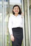 Young Asian female executive smiling Stock Photos