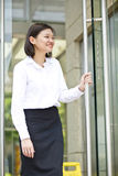 Young Asian female executive smiling Royalty Free Stock Images