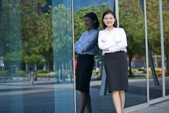 Young Asian female executive smiling Royalty Free Stock Image