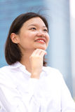 Young Asian female executive smiling portrait Stock Image