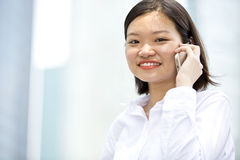 Young Asian female executive talking on phone Royalty Free Stock Photography