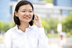 Young Asian female executive talking on phone Royalty Free Stock Image