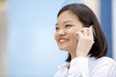 Young Asian female executive talking on phone Stock Photo