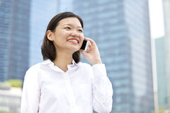 Young Asian female executive talking on phone Stock Photography