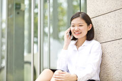 Young Asian female executive talking on phone Royalty Free Stock Photo