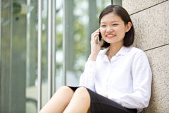 Young Asian female executive talking on phone Royalty Free Stock Photos