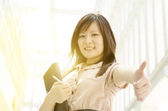 Young Asian female executive thumb up Royalty Free Stock Image