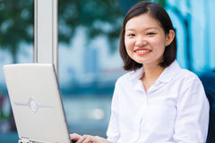 Young Asian female executive using laptop PC Royalty Free Stock Photography