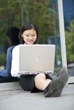 Young Asian female executive using laptop Royalty Free Stock Photos