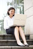 Young Asian female executive using laptop Stock Photo