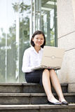 Young Asian female executive using laptop Stock Images
