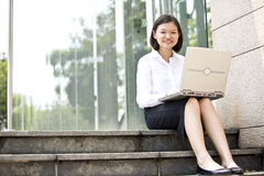 Young Asian female executive using laptop Royalty Free Stock Photo