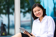 Young Asian female executive using tablet PC Royalty Free Stock Photos
