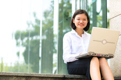 Young Asian female executive using tablet PC Stock Photography