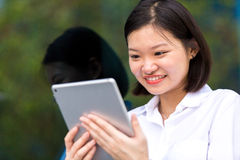 Young Asian female executive using tablet PC Royalty Free Stock Photography