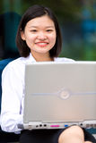 Young Asian female executive using tablet PC Stock Image