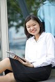 Young Asian female executive using tablet Royalty Free Stock Images