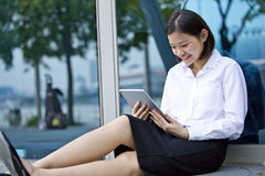 Young Asian female executive using tablet Stock Photography