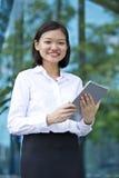 Young Asian female executive using tablet Stock Photos