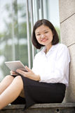 Young Asian female executive using tablet Royalty Free Stock Photography