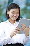 Young Asian female executive using tablet Royalty Free Stock Image