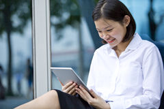 Young Asian female executive using tablet Royalty Free Stock Photo
