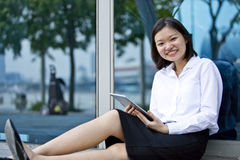 Young Asian female executive using tablet Stock Image