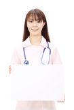 Young asian female nurse. Holding a blank white board Royalty Free Stock Photos