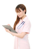 Young asian female nurse Royalty Free Stock Photos