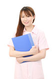 Young asian female nurse. Holding a file Stock Photo