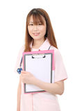 Young asian female nurse. Holding a file Stock Photography