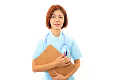 Young asian female nurse. Holding a clipboard Stock Images