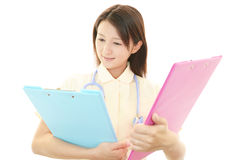 Young Asian female nurse. Portrait of an Asian female nurse Stock Photography