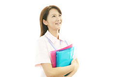 Young Asian female nurse. Portrait of an Asian female nurse Royalty Free Stock Photos