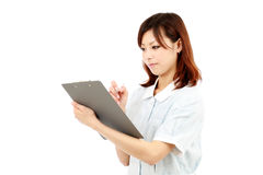 Young asian female nurse in uniform Royalty Free Stock Photos