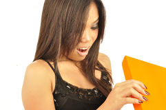 Young Asian female opening a gift box Stock Images