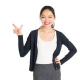Young Asian female pointing Royalty Free Stock Image