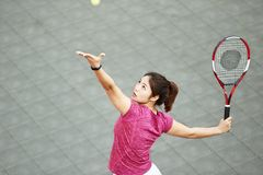 Young asian girl playing tennis stock images
