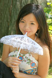 Young Asian Female  with Umbrella Stock Photography