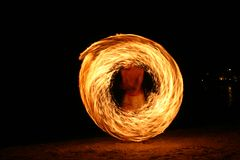 Young Asian Fire dancer Stock Photo