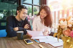 Young asian freelance working at home happiness and smiling face Stock Photography
