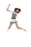 Young asian girl. Jumping up in the air Royalty Free Stock Photo